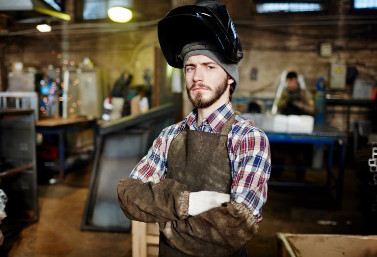welder in a leather welding apron