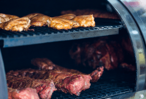 meat being grilled in a smoker