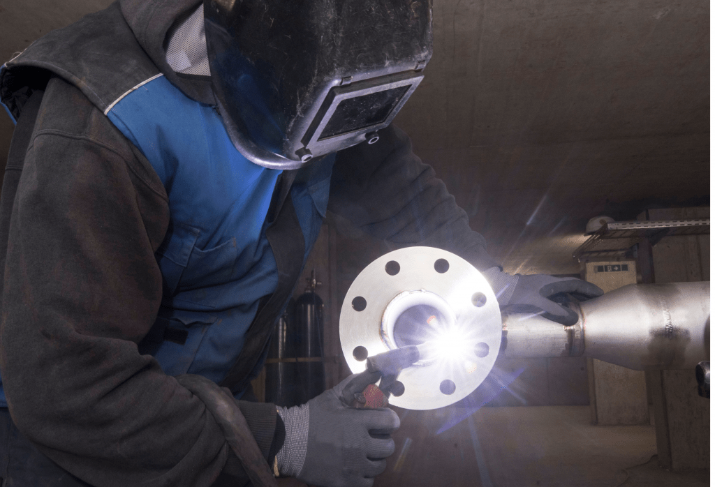 welder working wearing FR clothing